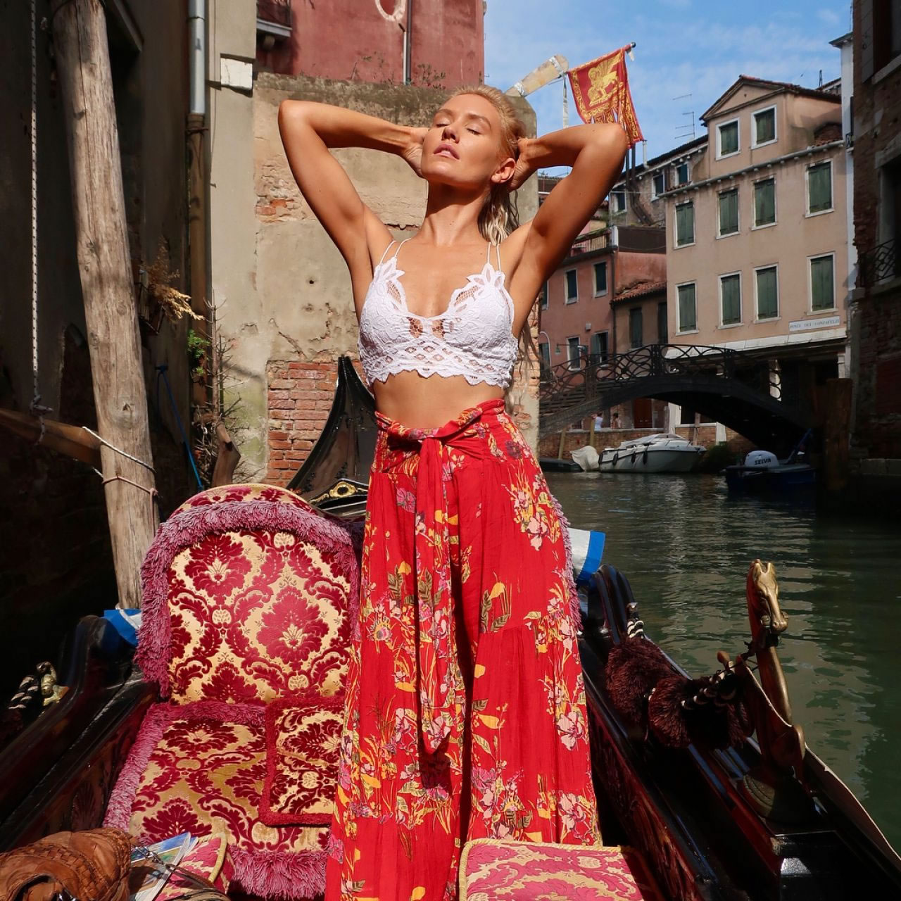 Nicky Whelan stretches in a canal.jpg