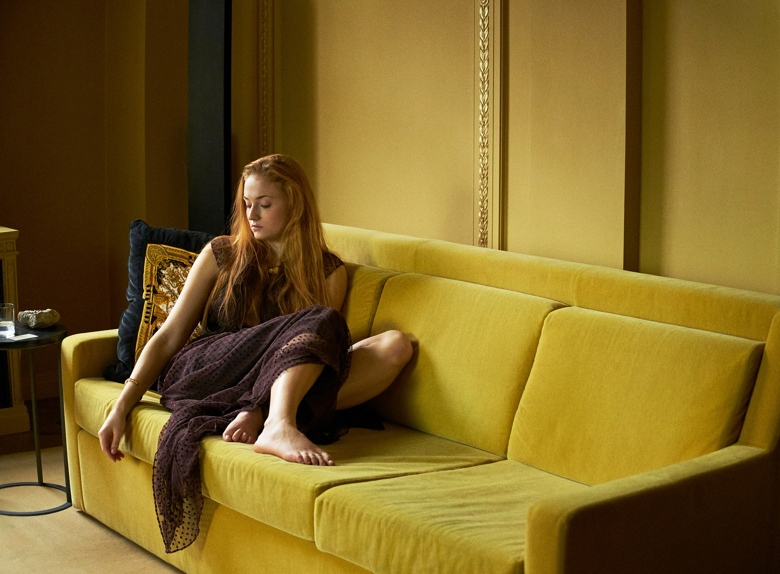 Sophie Turner on a golden couch.jpg
