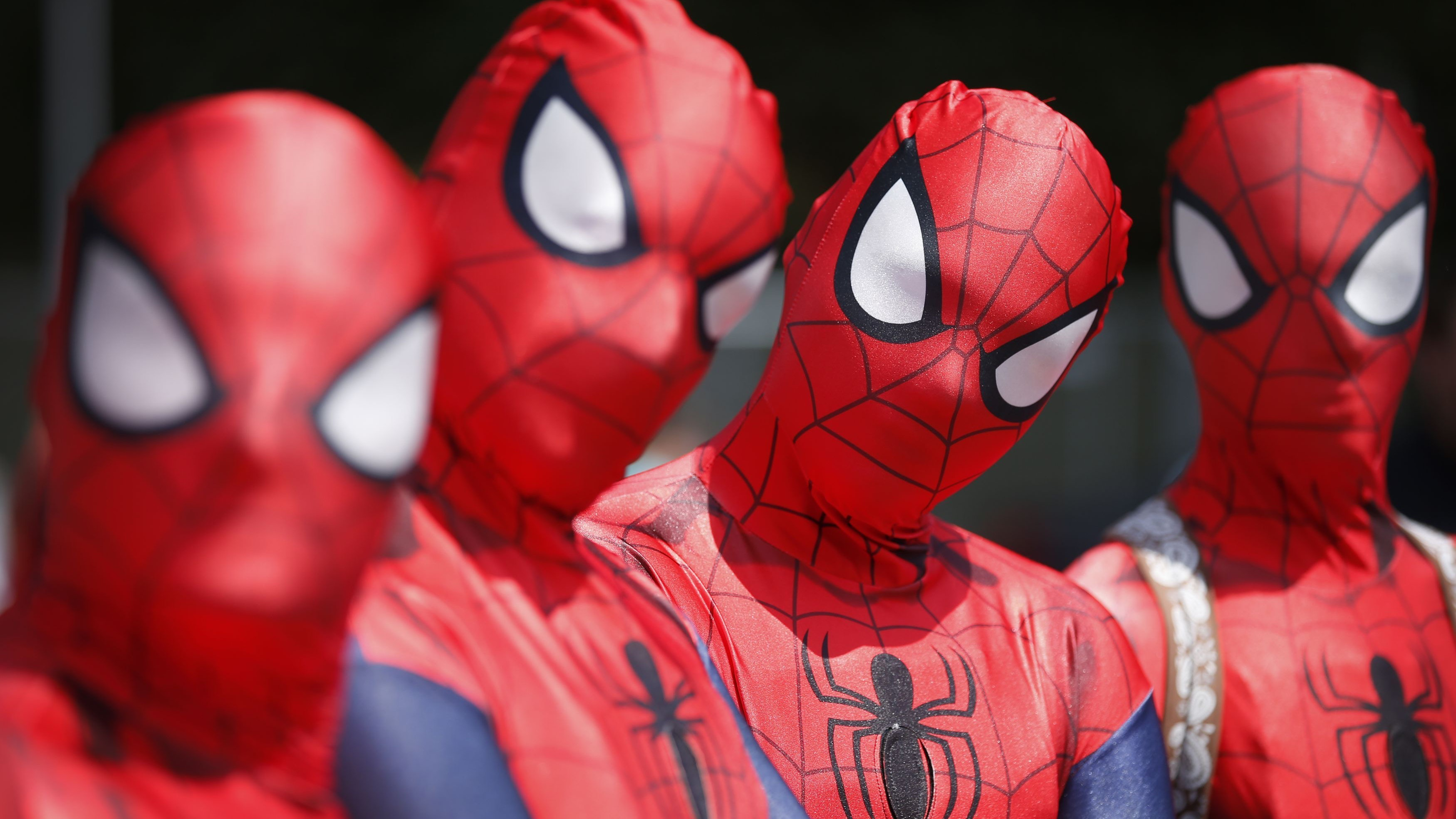 four spider cosplayers.jpg