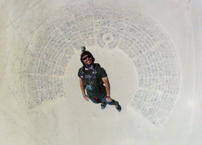 guy skydiving into burning man