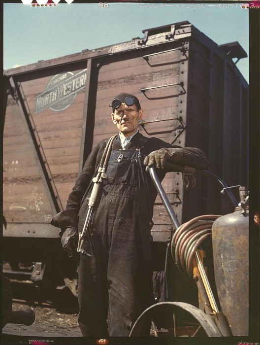 Mike Evans, a welder, at the rip tracks at Proviso yard of the Chicago and Northwest Railway Company. Chicago, Illinois, April 1943. 528x700 America circa 1939 1943 wtf