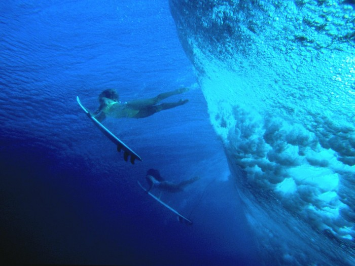 Surfer Girls Duck Diving Hawaii 700x525 Surfer Girls Duck Diving In Hawaii Wallpaper Sports