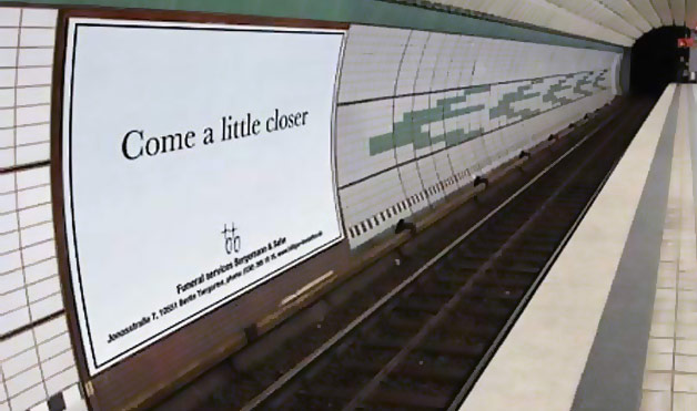 09-THE-FUNERAL-BILLBOARD-IN-THE-SUBWAY.jpg (50 KB)