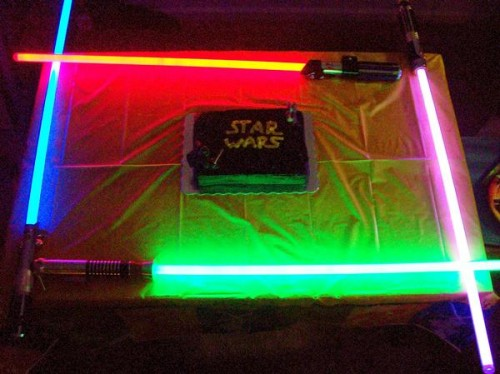 My first upload my 20th birthday cake with my lightsaber collection