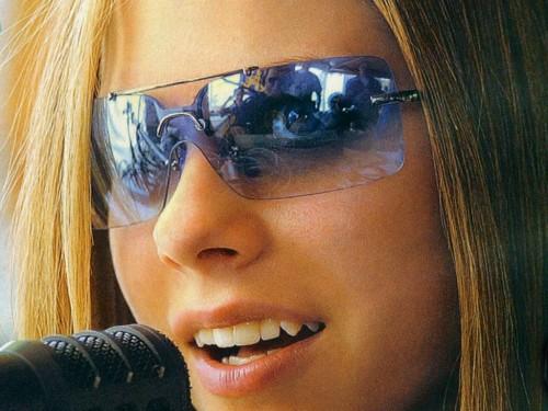 Avril Lavigne Has Blue Glasses