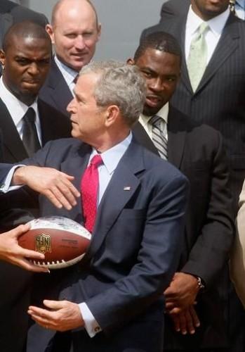 george bush with football vs black men