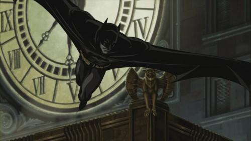 batman jumps past gargoyle