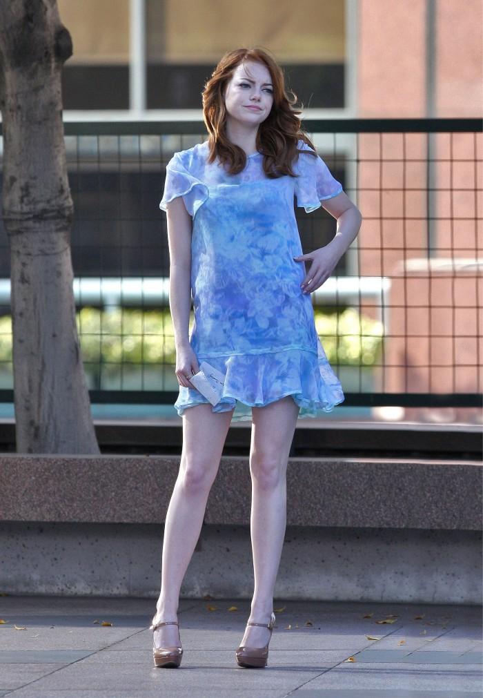 Emma holds her dress down.jpg