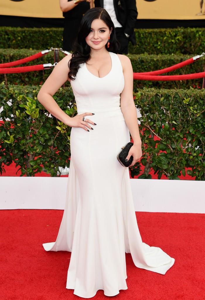 Ariel Winter in white dress looking forward.jpg