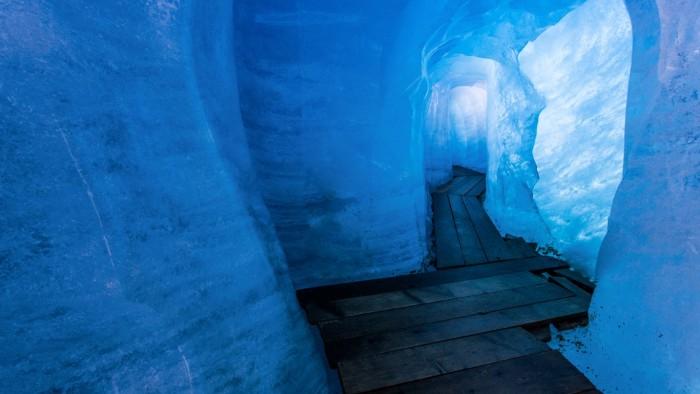 Glacier ice grotto in Valais, Switzerland.jpg
