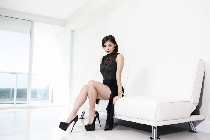 Asian on a Pure White couch.jpg