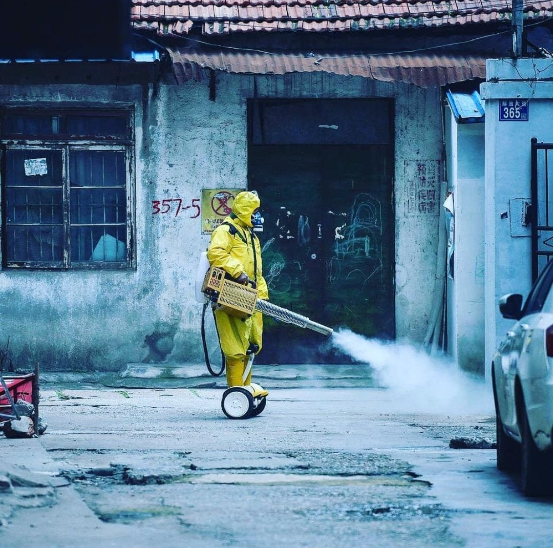 Worker spraying the streets to prevent Covid 19