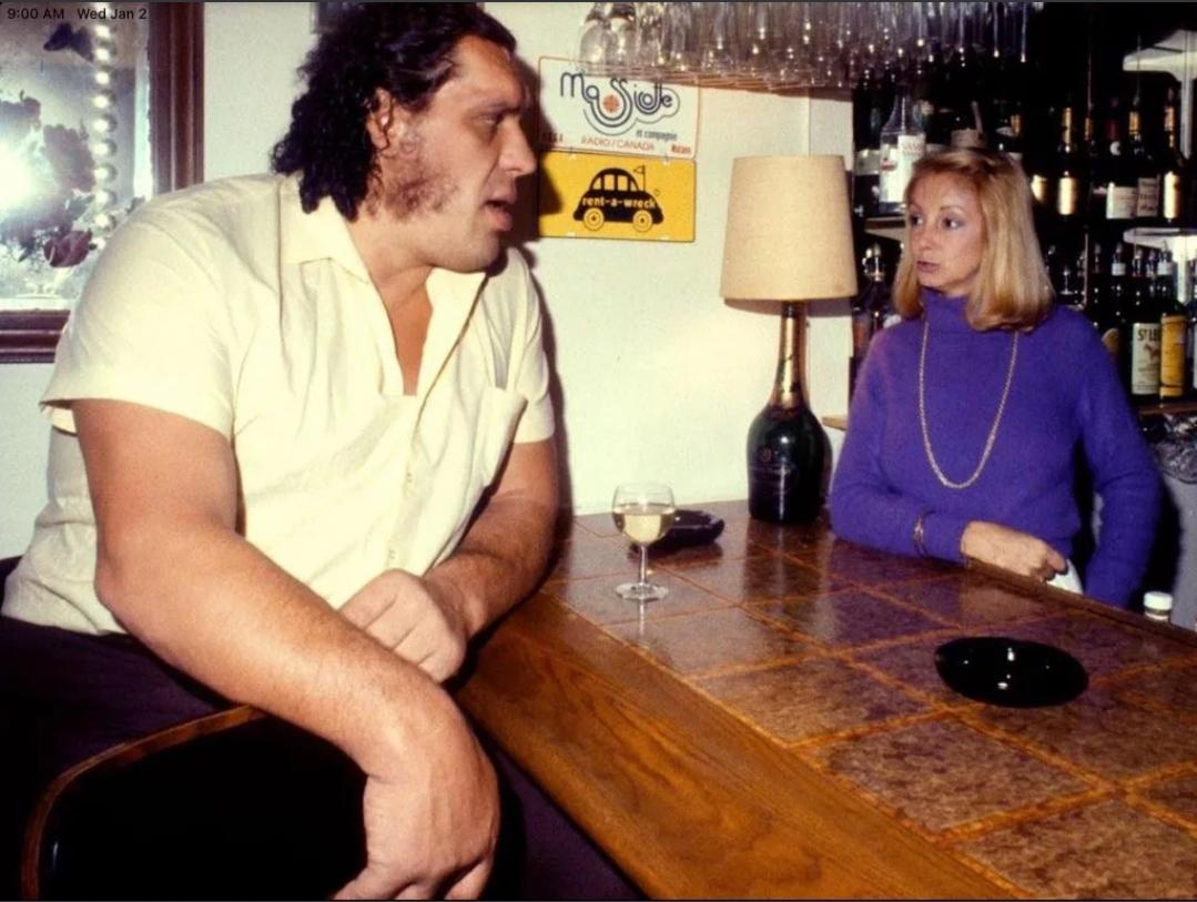 Andre the giant in a pub 1976 Barmaid for scale