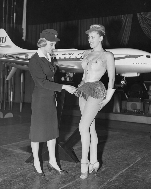 Swedish airline stewardess Birgitta Lindman who worked for the SAS Airline being inspected for the length of her outfit Late 50s