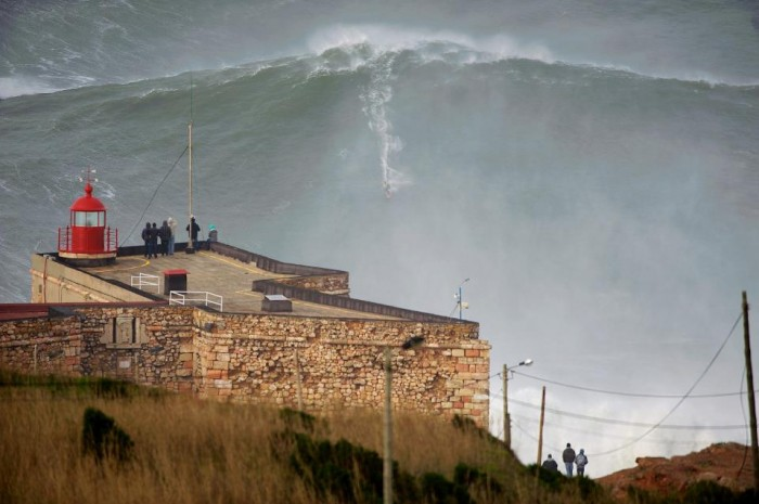 GarrettMcNamara. 700x465 Now THATS a wave. waves surfing awesome