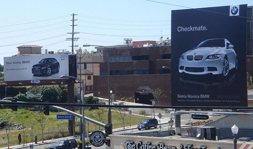 BMW V Audi Sign War 500x296 Audi and BMW billboards Humor Cars Advertisements